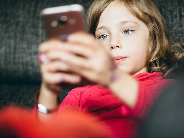 Most children own mobile phone by age of seven, study finds